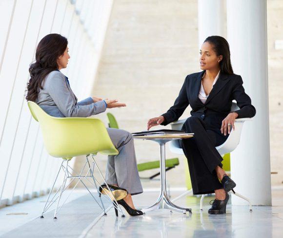 women coaching mentoring